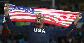 Kevin Durrant holding the US flag as part of the Olympic Team. Kevin Durrant has been a great example of sportsmanship and family.